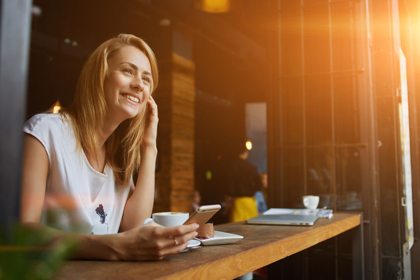 girl sitting in cafe smiling